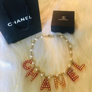 Chanel gold pearl red resin letter Necklace